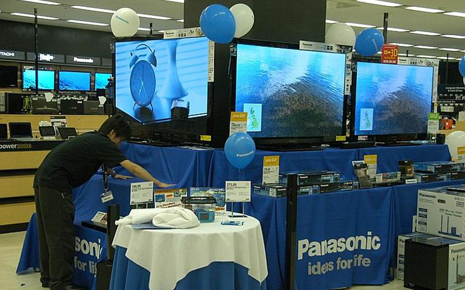 Televisions on display at the Yokota Base Exchange. An on-base summer energy savings program, such as the one implemented in 2011, will resume in 2012 in an effort to reduce demand for electricity.