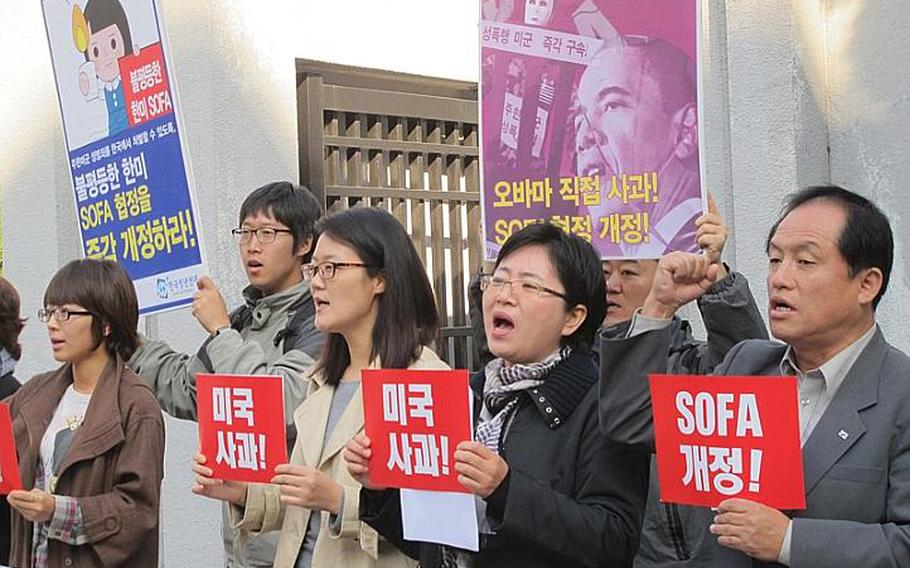 About 20 demonstrators protest at the Uijeongbu District Courthouse in October prior to the rape trial of an Army private who confessed to raping, beating and burning a 17-year-old South Korean girl. He later received a 10-year prison sentence. A second soldier accused of rape in September was taken into custody by South Korean authorities Tuesday, Dec. 13, 2011