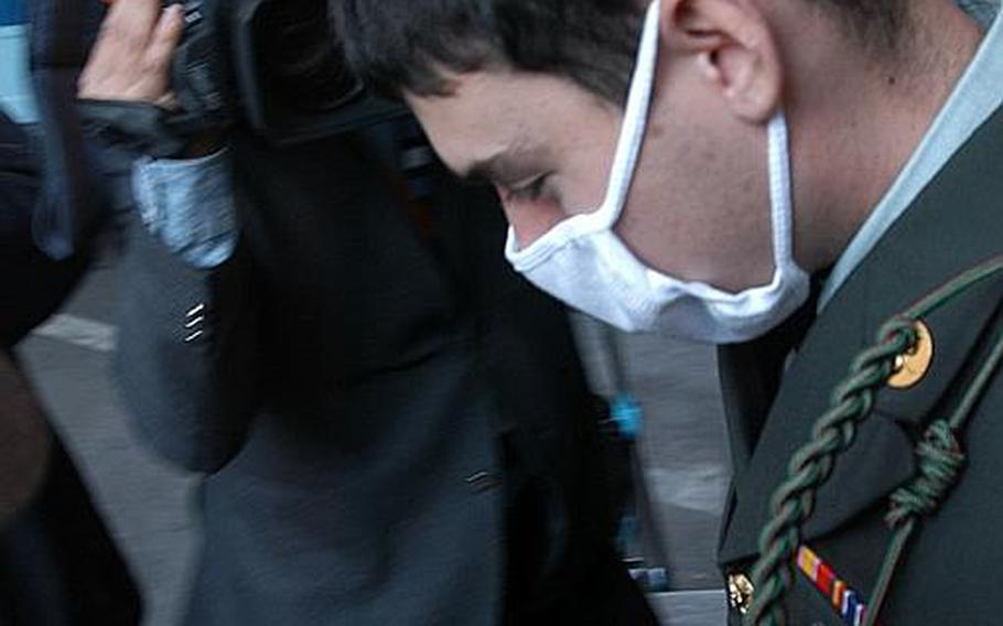 Pvt. Kevin Lee Flippin, 21, is led out of the Uijeongbu District Courthouse in South Korea after being sentenced Nov. 1, 2011, to 10 years in prison for the brutal Sept. 24 rape of a 17-year-old Korean girl.