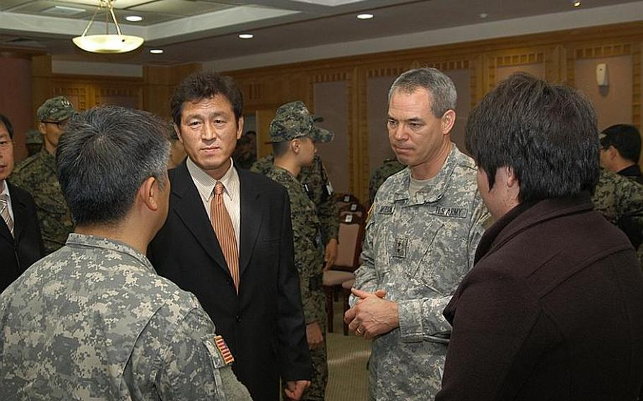 U.S. Army Maj. Gen. Bert Mizusawa, right, talks Nov. 23, 2011, with Jang Chun Ki after a ceremony marking the 27th anniversary of a 1984 firefight at the Demilitarized Zone. Jang'ss brother, Jang Myung-ki, was killed in the 40-minute standoff between soldiers from North Korea and the United Nations Command.