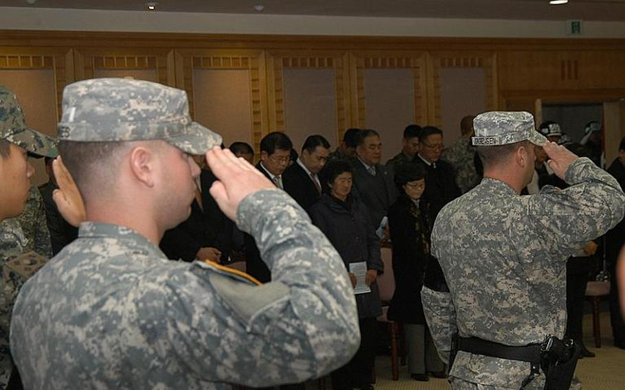 Family of Cpl. Jang Myung-ki, center, observe a moment of silence Nov. 23, 2011, during a ceremony at Korea's Demilitarized Zone marking the 27th anniversary of a firefight there in which Jang was killed.