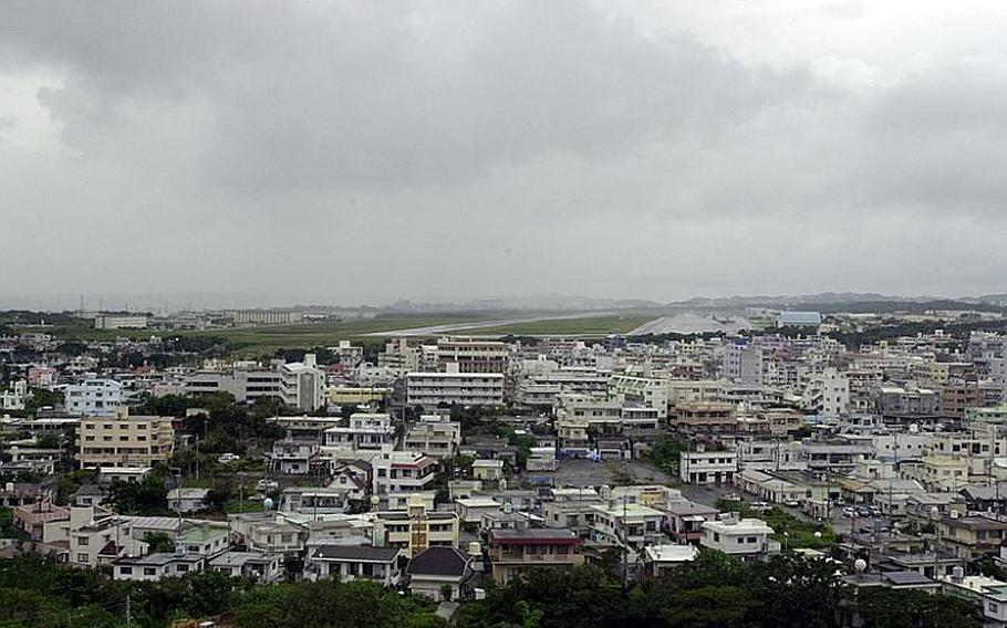 The southern end of the Futenma air station flight line sits adjacent to homes and businesses on Okinawa.