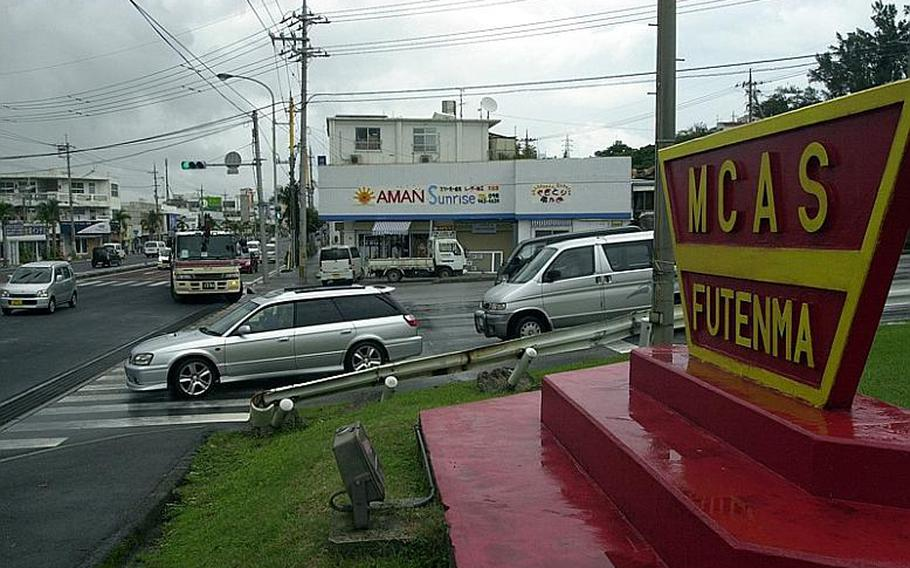 The main entrance to Marine Corps Air Station Futenma sits along busy Highway 58 about five miles south of Kadena Air Base on Okinawa.