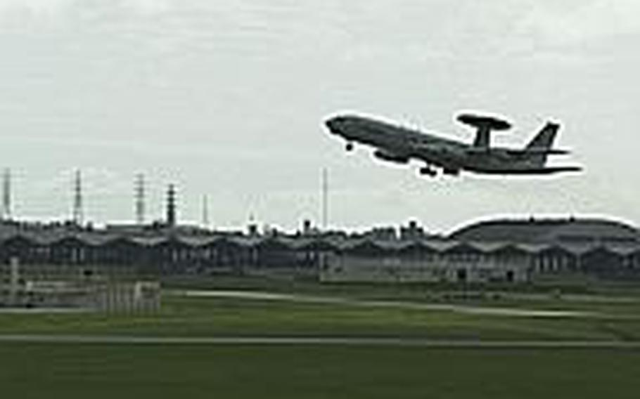 An E-3 Sentry takes off from Kadena Air Base Dec. 2, 2011, Congress might study moving nearby Marine Corps operations onto the base as well.