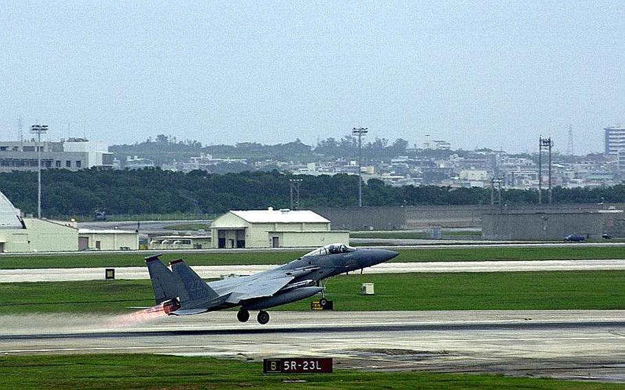 An F-15 Eagle, one of 54 stationed at Kadena Air Base, takes off Dec. 2, 2011. Congress wants to study whether flight operations from Marine Corps Air Station Futenma can also be moved to the air base.