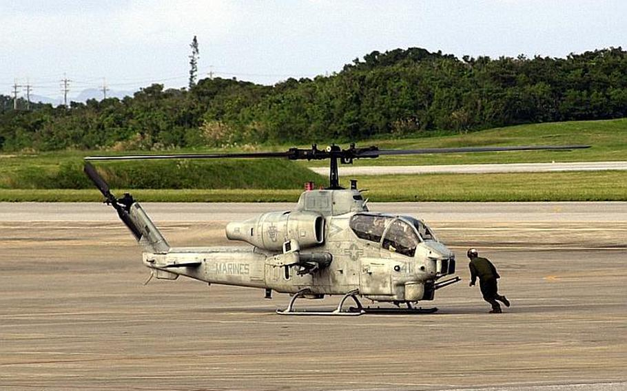 An AH-1W Super Cobra prepares for takeoff Dec. 2, 2011, at Marine Corps Air Station Futenma. Congress wants to study whether the helicopters and other air operations could be moved up the road to Kadena Air Base.