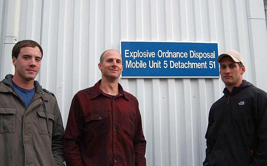 From left to right, Petty Officer 3rd Class Adam Andryc, Petty Officer 1st Class Corey Baughman, and Petty Officer 1st Class Dillon Mudloff, of Explosive Ordinance Disposal Mobile Unit 5, Detachment 51. The trio of bomb technicians saved the life of a Japanese national while climbing Mt. Fuji on Dec. 9-12, 2011. The sailors got more than they bargained for on what turned out to be a harrowing weekend on the mountain. Baughman suffered frostbite staying on the mountain overnight with the man fell. Baughman's efforts helped the man fight off shock and certain death. The man was rescued the next day.