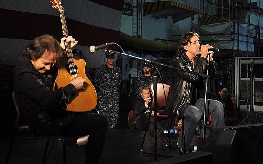 Guitarist Brent Look, left, and Creed singer Scott Stapp entertain sailors and thier families aboard the USS George Washington in Yokosuka, Japan, on March 18, 2012. Stapp and his entourage thanked the servicemen and women for their relief efforts after the 2011 tsunami.