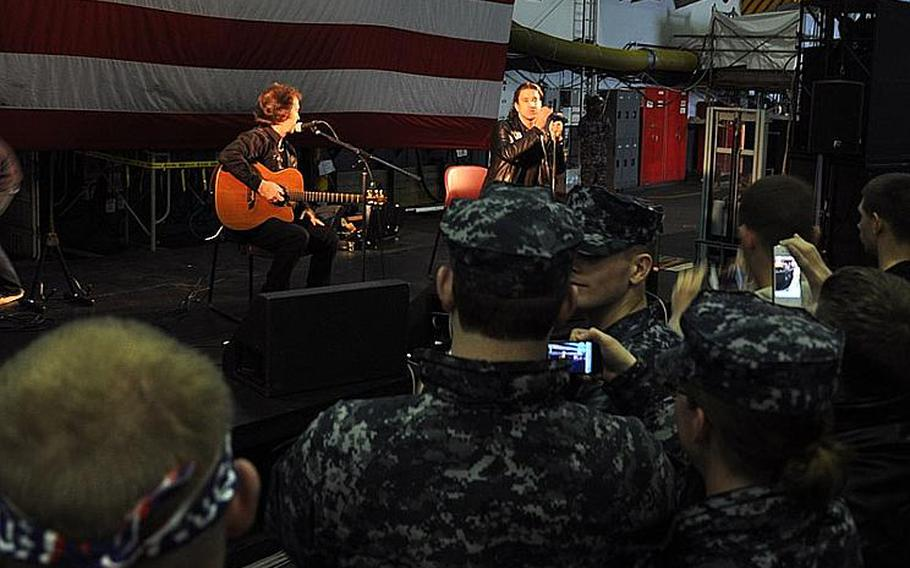 Creed singer Scott Stapp and guitarist Brent Look perform for a group of servicemembers and their families about the USS George Washington at Yokosuka Naval Base on March 18, 2012. After visiting the tsunami devastated Sendai, Stapp said he wanted to thank the military for thier relief efforts.