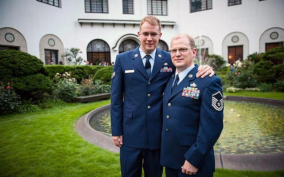 Senior Airman Luke Bullard, left, and Master Sgt. Marc Maschhoff, both from Misawa Air Base, Japan, pose for a photo June 4, 2012, at the home of U.S. Ambassador to Japan John Roos in Tokyo. The ambassador held a reception Monday evening to commemorate Lesbian, Gay, Bisexual, Transgender Pride Month, which President Barack Obama has proclaimed each June since taking office in 2009.