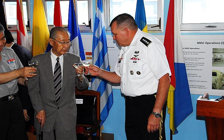 U.S. Forces Korea commander Gen. James Thurman, right, shares a toast July 27, 2012, with retired South Korean Gen. Paik Sun-yup at the Demilitarized Zone during a ceremony marking the 59th anniversary of the armistice that effectively ended the Korean War.