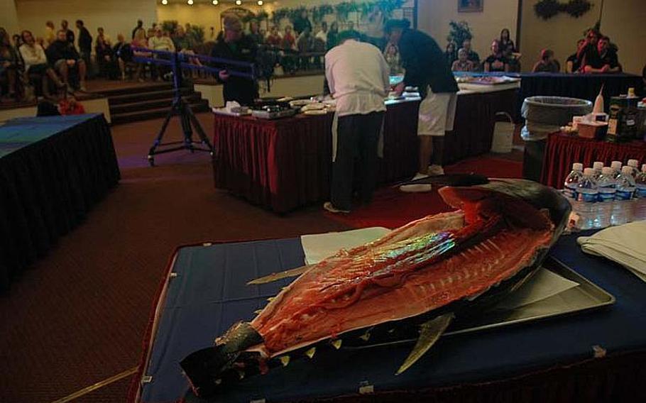 "After fileting a 100-pound tuna, ""Iron Chef"" Masaharu Morimoto prepared a variety of fish dishes during a cooking demonstration Nov. 4, 2012, at Yokota Air Base, Japan."