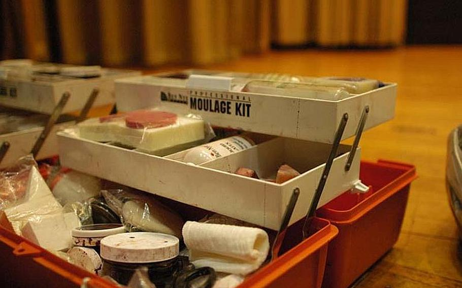 """The moulage kit seen here was used to simulate injuries on about 20 """"victims"""" during a mock disaster exercise at Yokota Air Base, Japan, on Nov. 6, 2012. The U.S. military trains troops in the art of moulage, a French term for applying mock injuries for emergency response training."""