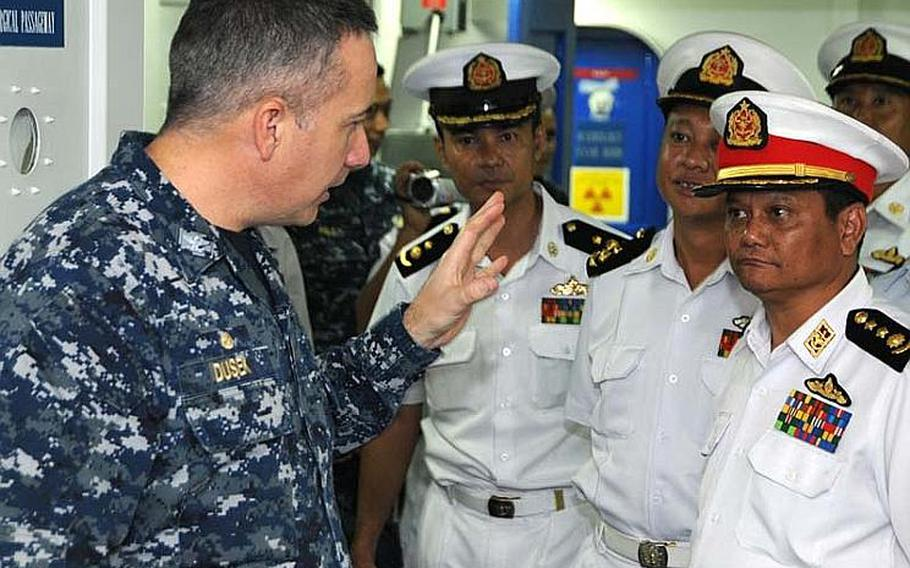 Capt. Daniel Dusek, commanding officer of the amphibious assault ship USS Bonhomme Richard, shows the ship's medical bay to Myanmar naval officers on Nov. 18, 2012, in the Andaman Sea. Although sanctions prevent a large-scale relationship between the two militaries, the two countries are exploring academic and small-group exchanges.