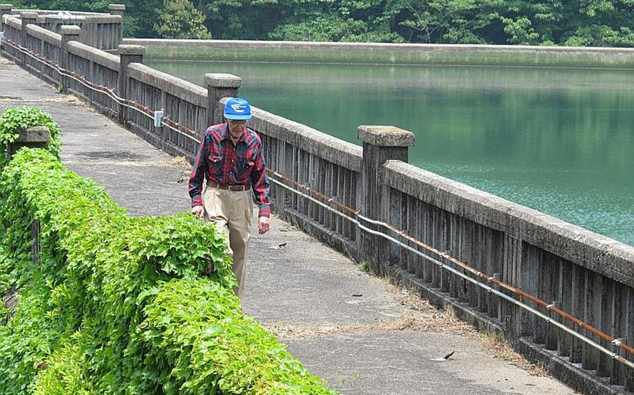 Leroy Myers leaves Sasebo's Soto Dam after the 93-year-old came back to see it one final time May 25, 2013, 72 years after his captivity and forced labor during World War II.