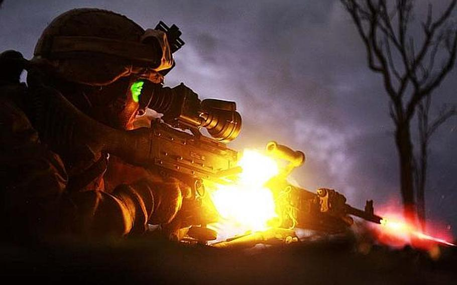 Pfc. Sebastian Rodriguez, a machine-gunner with the Marine Corps rotational force in Darwin, Australia, fires his weapon during a night exercise in May 2013.