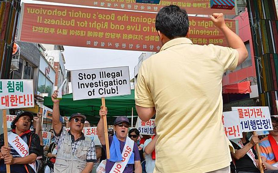South Korean protesters rally against the 51st Fighter Wing command at the Songtan Entertainment District outside Osan Air Base, South Korea, June 14, 2013. They were protesting the command's decision to make some bars off-limits.