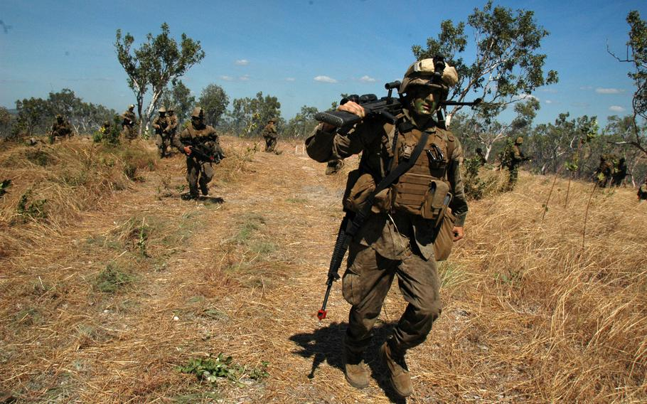U.S. Marines move forward in support of Australian soldiers during an exercise at Mount Bundey Training Area, Northern Territory on Thursday.