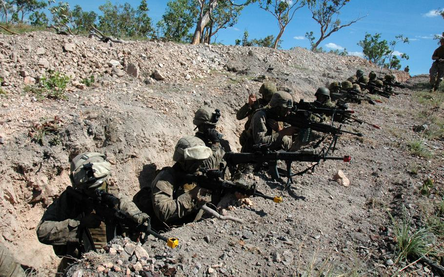 U.S. Marines and Australian soldiers take cover in a trench during an exercise at Mount Bundey Training Area, Northern Territory on Thursday.