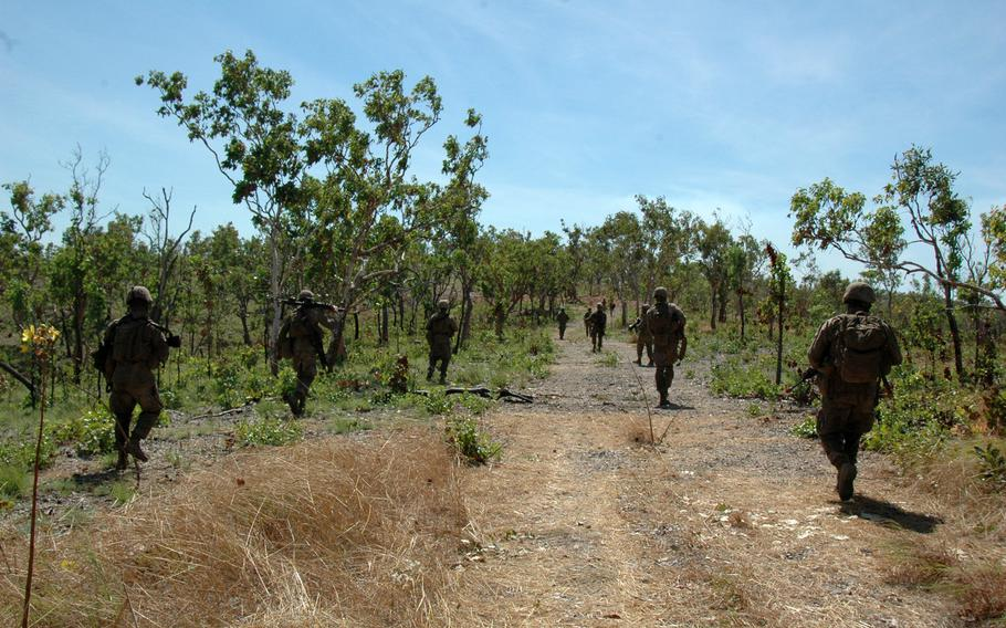 Marines move through Mount Bundey Training Area, Northern Territory, during an exercise with Australian soldiers on Thursday.
