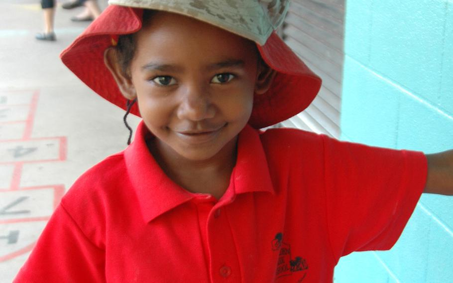 Nancy Issac, 5, a Torres Strait Islander, sports a Marine's cover at Moulden Park Primary School.