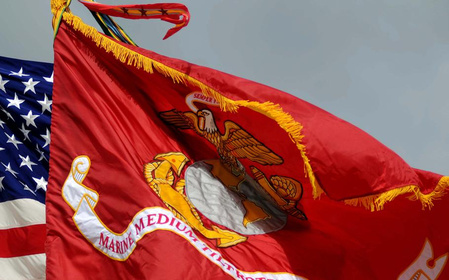 The new battle colors wave after the unveiling aboard Marine Corps Air Station Futenma, Okinawa, Aug. 30, 2013.