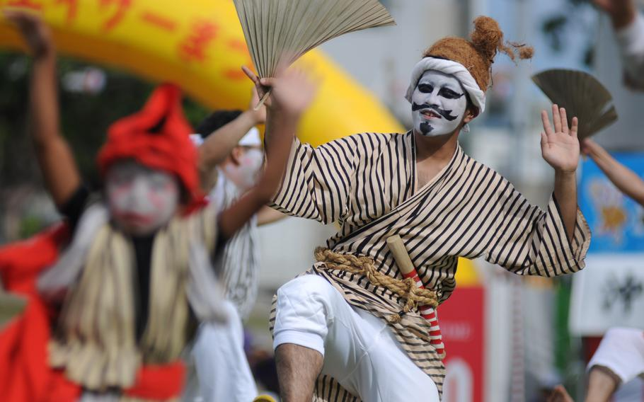 Dancers and musicians put on a colorful spectacle at the 58th Okinawa Zento Eisa Matsuri contest in Okinawa City, Okinawa, Sept. 1, 2103.