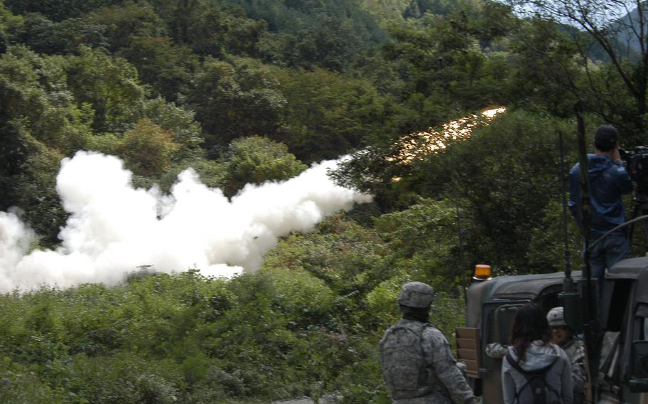 A rocket is fired during a U.S. military training exercise Sept. 25, 2013, near the Demilitarized Zone in South Korea. Crews from the 2nd Infantry Division's 6th Battalion, 37th Field Artillery Regiment, 210th Fires Brigade, were putting their Multiple Launch Rocket Systems through their their paces as part of the process they must go through every six months to maintain their certification.