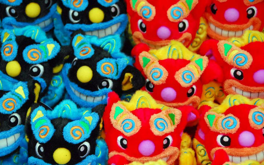 Brightly colored stuffed shisa dogs -- an Okinawa icon -- are sold in the park gift shop.