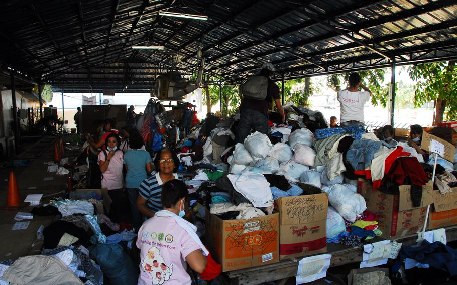Volunteers at Villamor Air Base in Manila separate piles of donated clothing that will be given to Typhoon Haiyan evacuees from Tacloban and the surrounding areas. The U.S. military has flown nearly 11,600 evacuees to Villamor since the storm hit earlier this month.