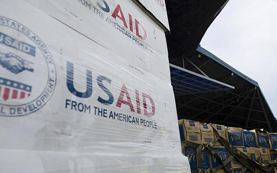 Boxes of relief supplies wait at Villamor Air Base in the Philippines.