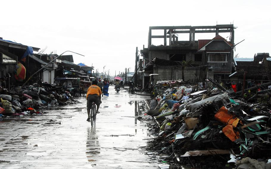 Trash piles up on the streets of typhoon devastated Guiuan on Friday.