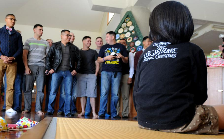 Marines and family members of 3rd Intelligence Battalion introduce themselves at the Nagomi Nursing Home for Children in Kin, Okinawa, Dec. 23, 2013.   Lisa Tourtelot/Stars and Stripes