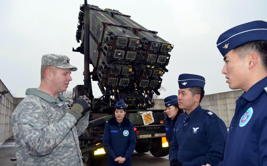 Capt. Edward Ellingson, public affairs officer for the 35th Air Defense Artillery Brigade, explains the U.S. Patriot missile system to Republic of Korea air force cadets during their visit to Osan Air Base, South Korea, Jan. 21, 2014. Nearly 100 cadets took part in the trip.