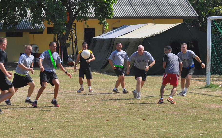 Soldiers play a game of early morning soccer at Puslatpur Marine Base during Garuda Shield exercise. Most mornings Indonesian and American soldiers joined in PT and soccer games.