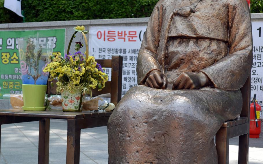 The Pyeonghwa-bi, Peace Monument, sits across the street from the Japanese Embassy in Seoul, South Korea. The monument is a representation of Koreans who were forced into sexual slavery by the Japanese military during World War II.