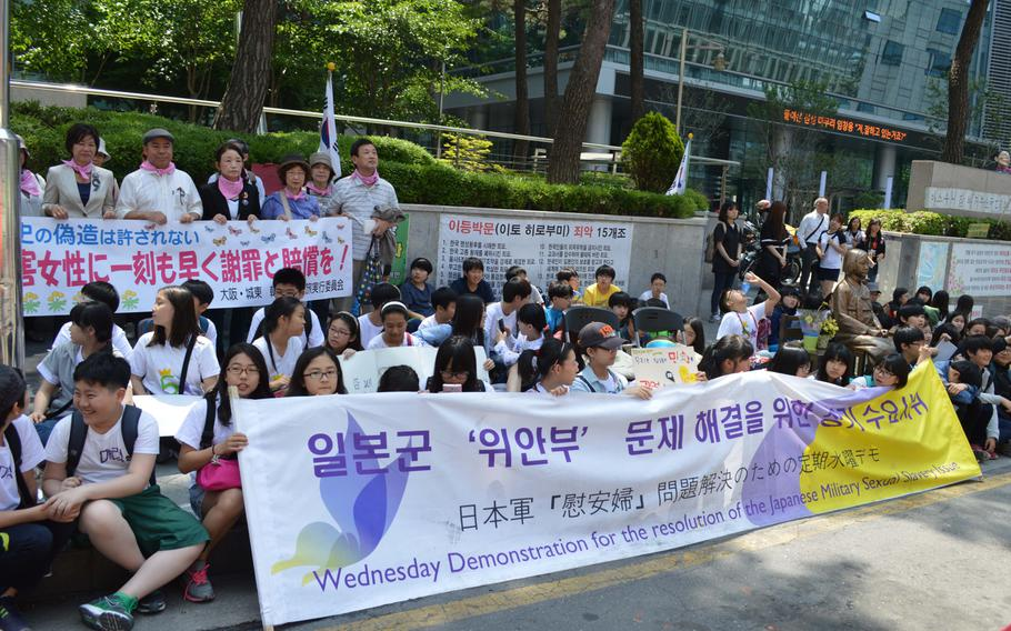 Adults and children hold a protest across the street from the Japanese Embassy in Seoul, South Korea, on May 21, 2014. Koreans regularly protest the embassy over Japan forcing women into sexual slavery during World War II.