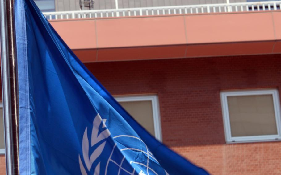 The United Nations flag flutters in the air across the street from the Japanese Embassy in Seoul, South Korea, on May 21, 2014. The South Korean representative to the U.N. has called for the Japan to compensate victims forced into prostitution during World War II.