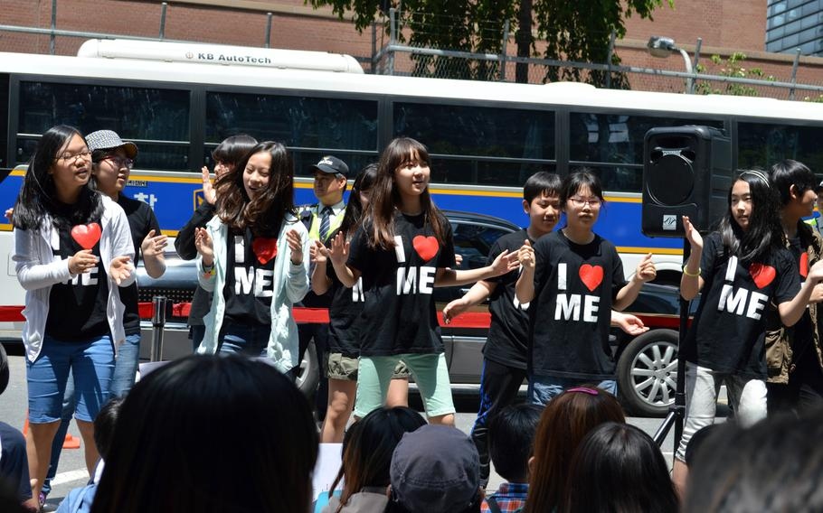 Korean children sing a song during a protest across the street from the Japanese Embassy in Seoul, South Korea, on May 21, 2014. A protest is held every Wednesday over the issue of Korean women forced into sexual slavery by Japan during World War II.