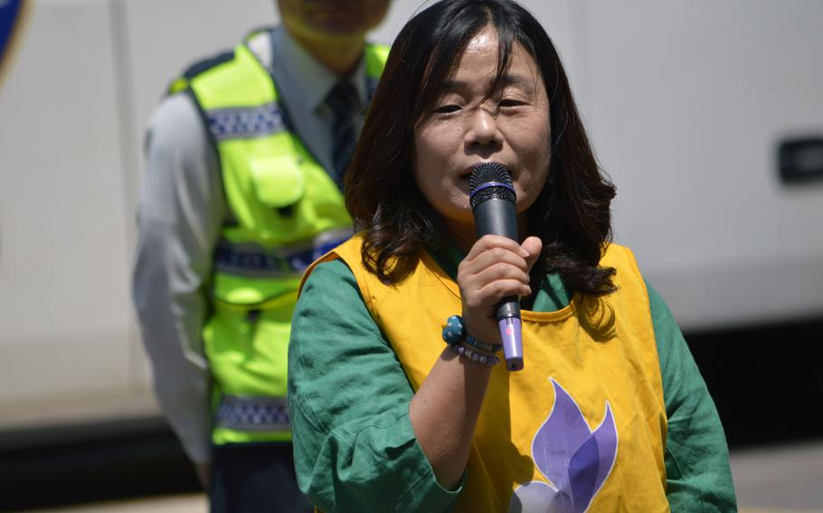 A Korean protester speaks during a protest across the street from the Japanese Embassy in Seoul, South Korea, on May 21, 2014.