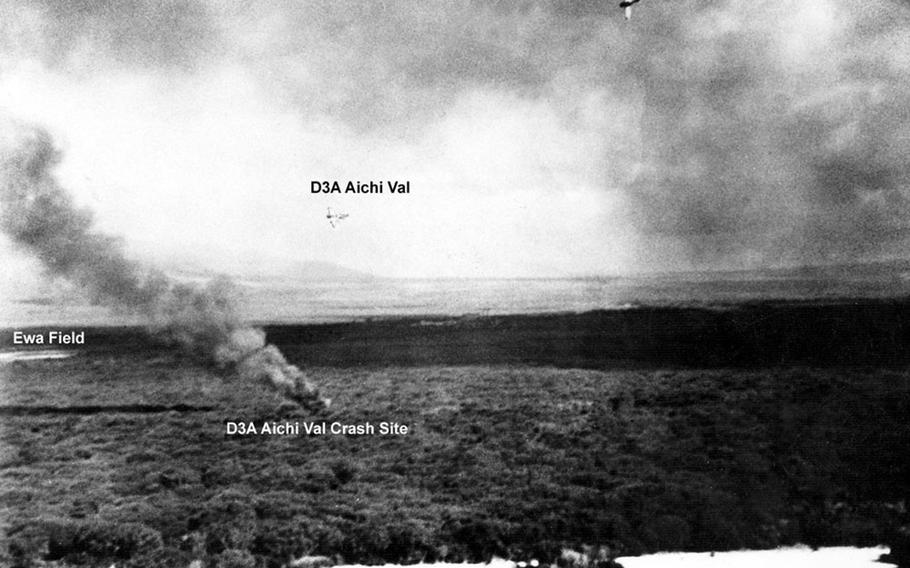 The area around Ewa Field was a busy battlefield on the morning of Dec. 7, 1941. While aboard a B17 that morning, Army photographer Lee Embree snapped this photo of the crash site of a Japanese dive bomber as two more of them circle above it.