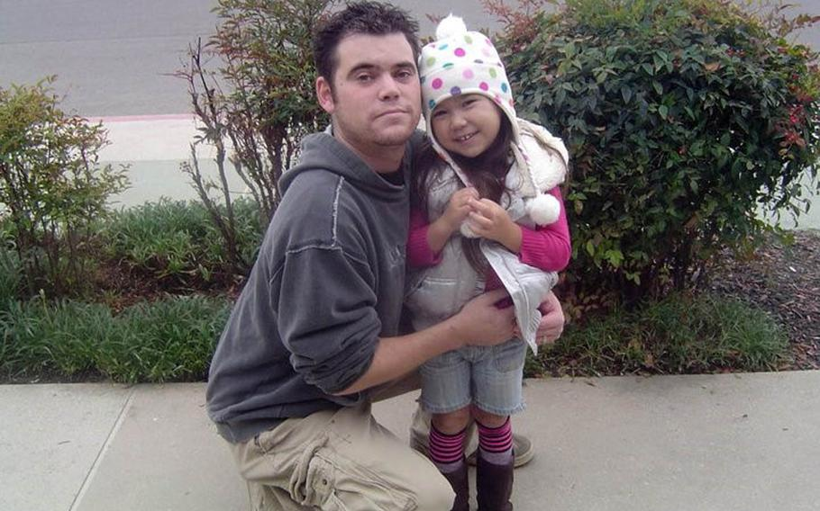 Donny and Christina Conway pose near their former near Naval Air Station Lemoore, Calif., in this undated photo. Conway hasn't seen or heard from his daughter, who is believed to be in Japan, since 2012.