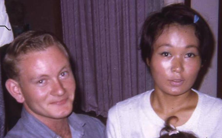 James Walker poses with his Japanese girlfriend, Tomie, and daughter, Kim, at their apartment near Atsugi in 1969. Walker lost touch with his Japanese family after being sent to Vietnam.