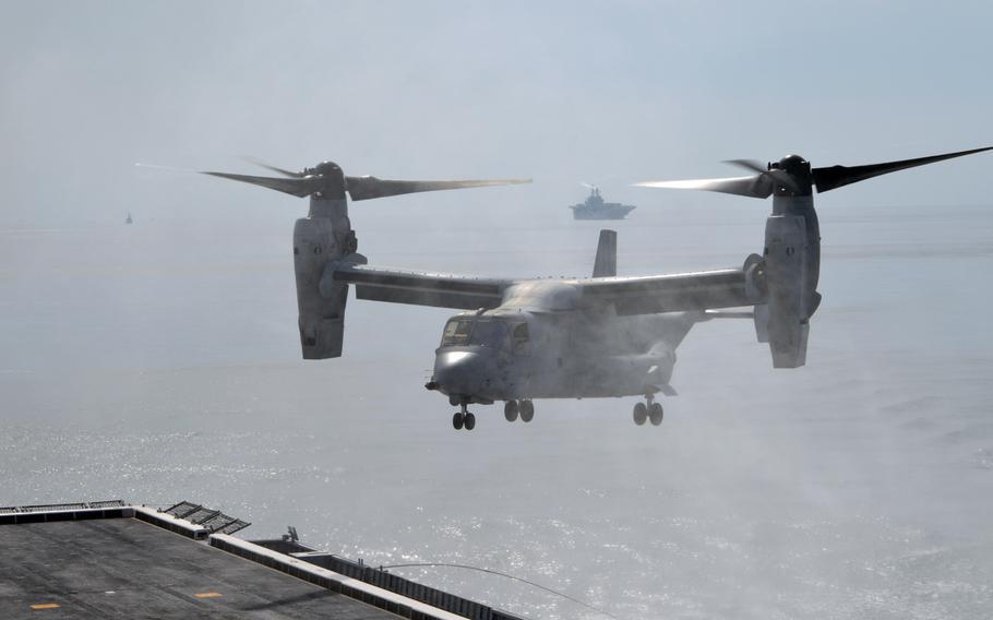 A U.S. Marine Corps MV-22 Osprey sends up an ocean spray as it nears the deck of the ROKS Dokdo on March 26, 2015. The MV-22 belongs to the Marine Medium Tiltrotor Squadron 262 Reinforced.