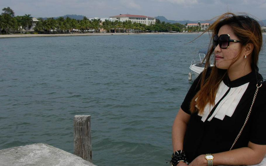 Marilou Laude, whose transgender sister, Jennifer, was found dead after checking into an Olongapo hotel with a U.S. Marine on Oct. 11, 2014, stands on a jetty in Subic Bay, Philippines, near Pier One, a beachfront bar and restaurant frequented by American personnel before Jennifer Laude's death.