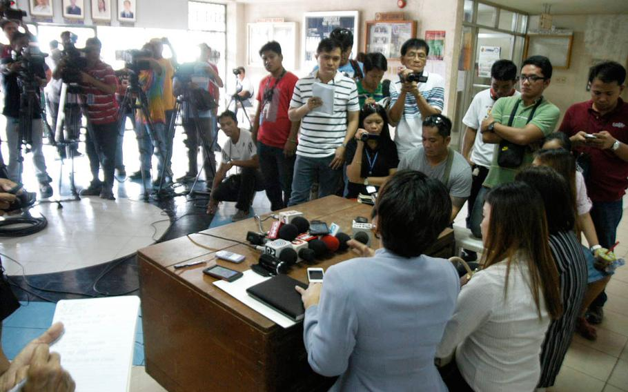 Virgie Suarez, center left, an attorney for the late Jennifer Laude's family, and family members talk to journalists during the trial of U.S. Marine Pfc. Joseph Scott Pemberton, who is accused of the killing of Laude in October 2014.