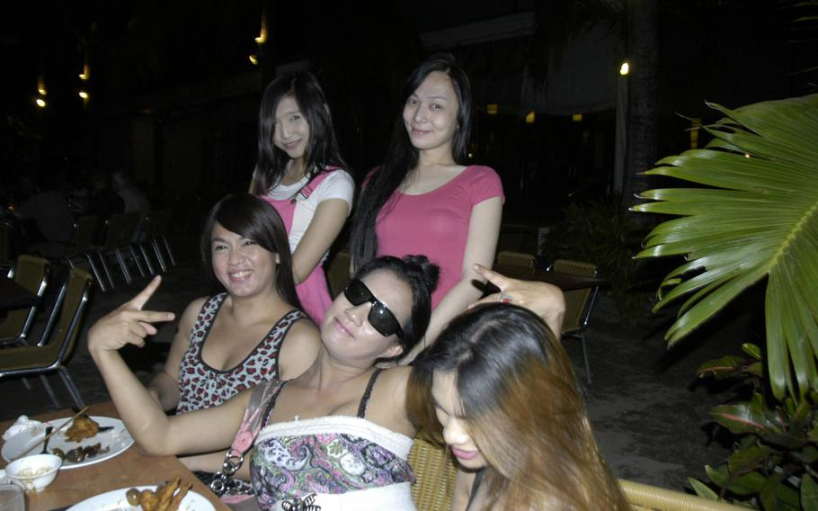 A group of Jennifer Laude's transgender Filipina friends pose in Olongapo City, Philippines, in March 2015.