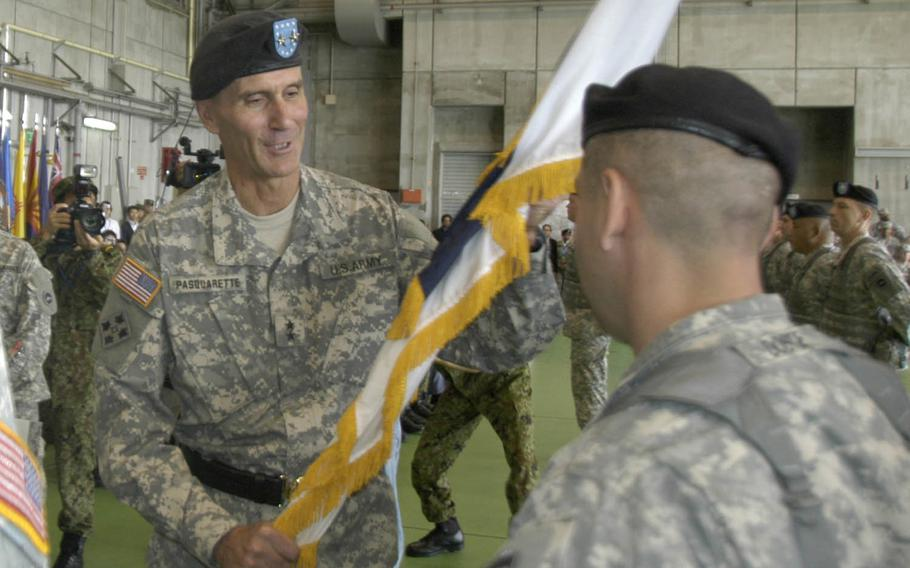 Maj. Gen. Jim Pasquarette, the new U.S. Army Japan commander, receives the I Corps (Forward) colors Wednesday at Camp Zama. Pasquarette said his priority will be building the relationship with Japan Ground Self Defense Force. He will also focus on maintaining positive relationships with communities, supporting soldiers and contributing to the joint efforts of U.S. Army Japan, he said.