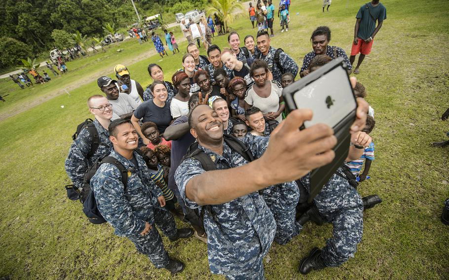 Command Master Chief Dedrick Walker, attached to the Military Sealift Command hospital ship USNS Mercy, takes a group selfie during Pacific Partnership, June 28, 2015. Mercy was  in Papua New Guinea for its second mission port of Pacific Partnership.