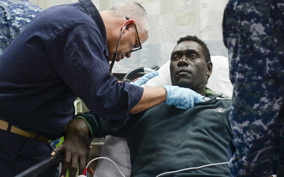 Medical personnel aboard the Military Sealift Command  hospital ship USNS Mercy give an injured person medical care during Pacific Partnership, June 30, 2015.   Mayra A. Conde/U.S. Navy